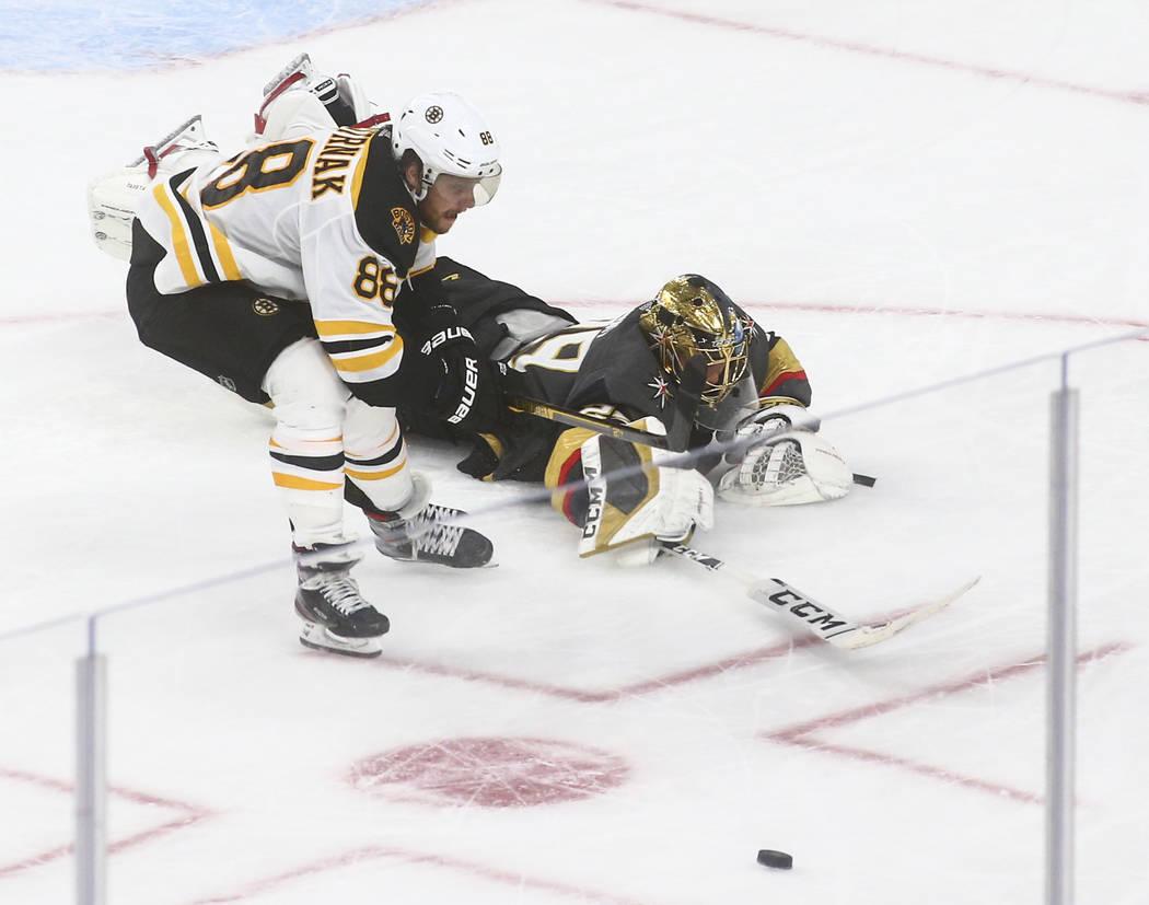 Golden Knights goaltender Marc-Andre Fleury (29) blocks a shot in front of Boston Bruins' David ...