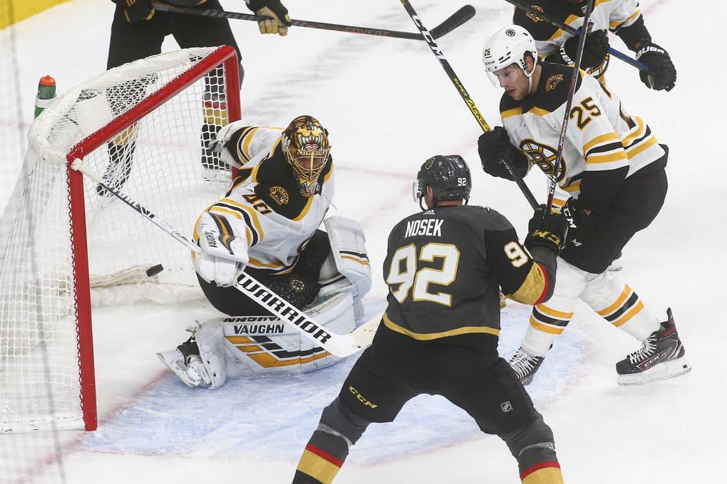 Boston Bruins goaltender Tuukka Rask (40) blocks a shot in front of Golden Knights' Tomas Nosek ...