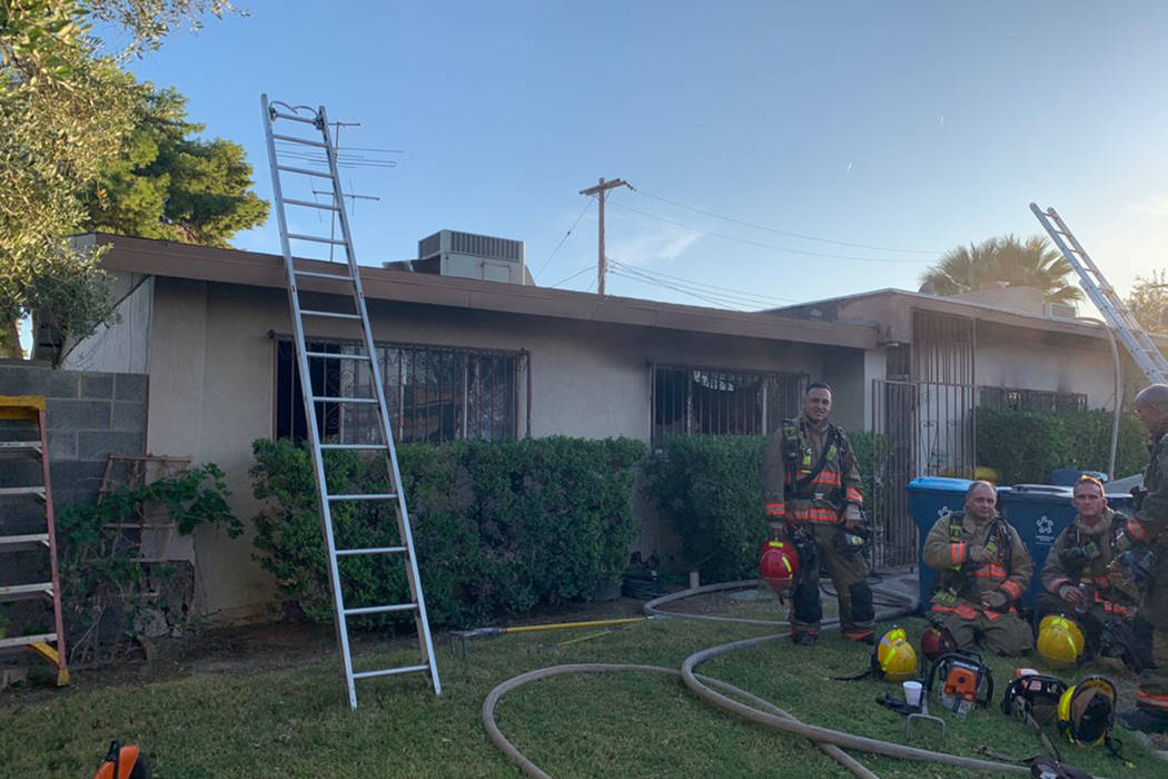 Crews battle a fire Tuesday, Oct. 8, 2019, on the 4500 block of Palmdale Court in Las Vegas. (C ...