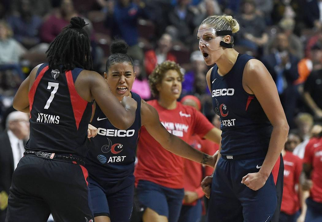 Washington Mystics' Elena Delle Donne, right, celebrates a play with Ariel Atkins, left, and Na ...