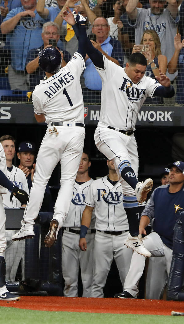 Tampa Bay Rays' Willy Adames (1) celebrates his solo home run against the Houston Astros with r ...