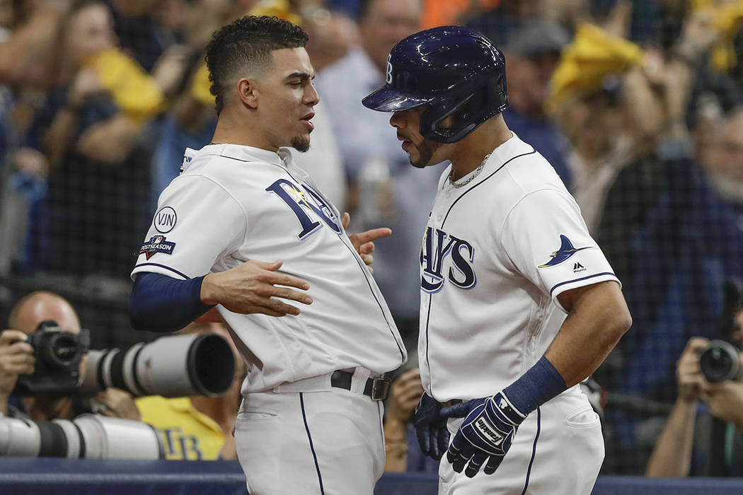 Tampa Bay Rays' Tommy Pham, right, celebrates his home run against the Houston Astros with team ...
