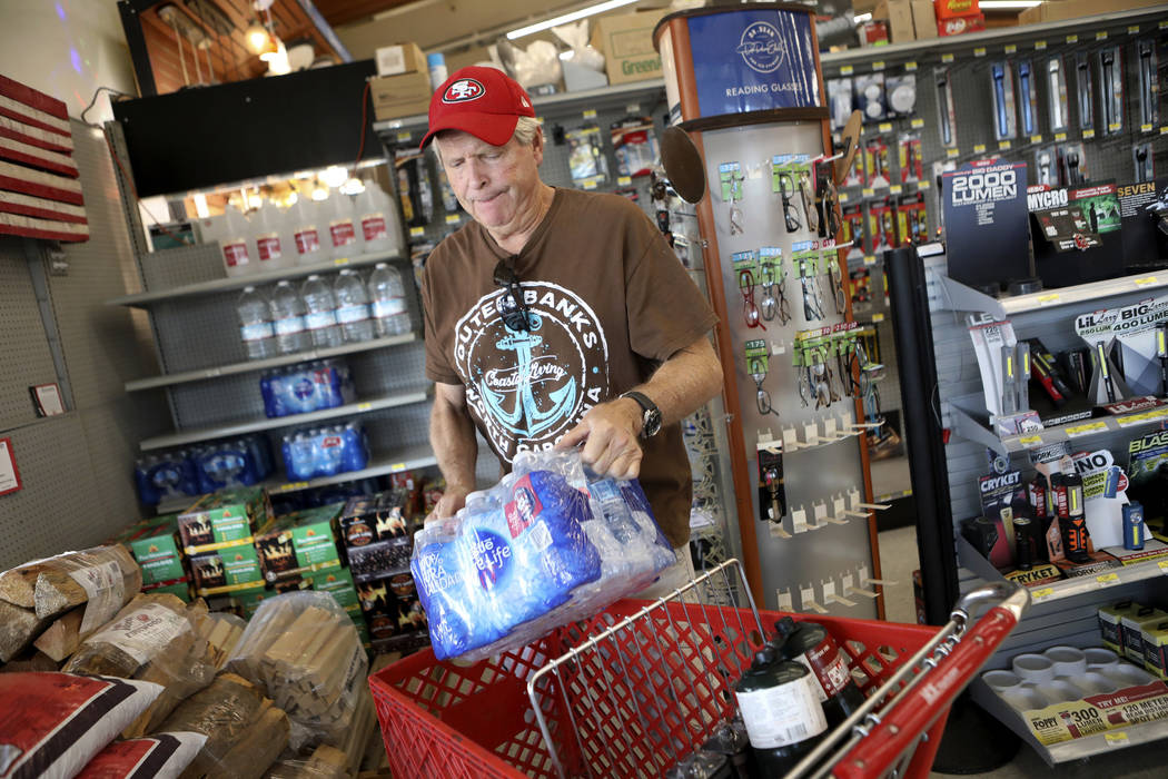 James Cooke is shown buying water bottles along with propane tanks and batteries at a ACE Hardw ...