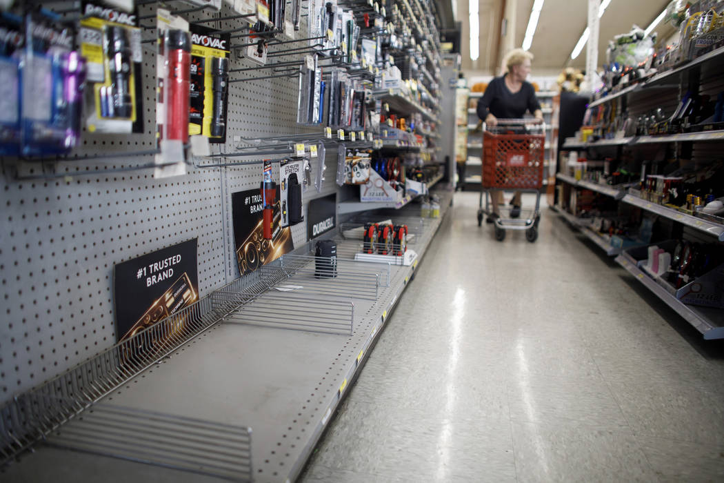 The lantern section is nearly empty at an ACE Hardware store as shoppers prepare for possible p ...