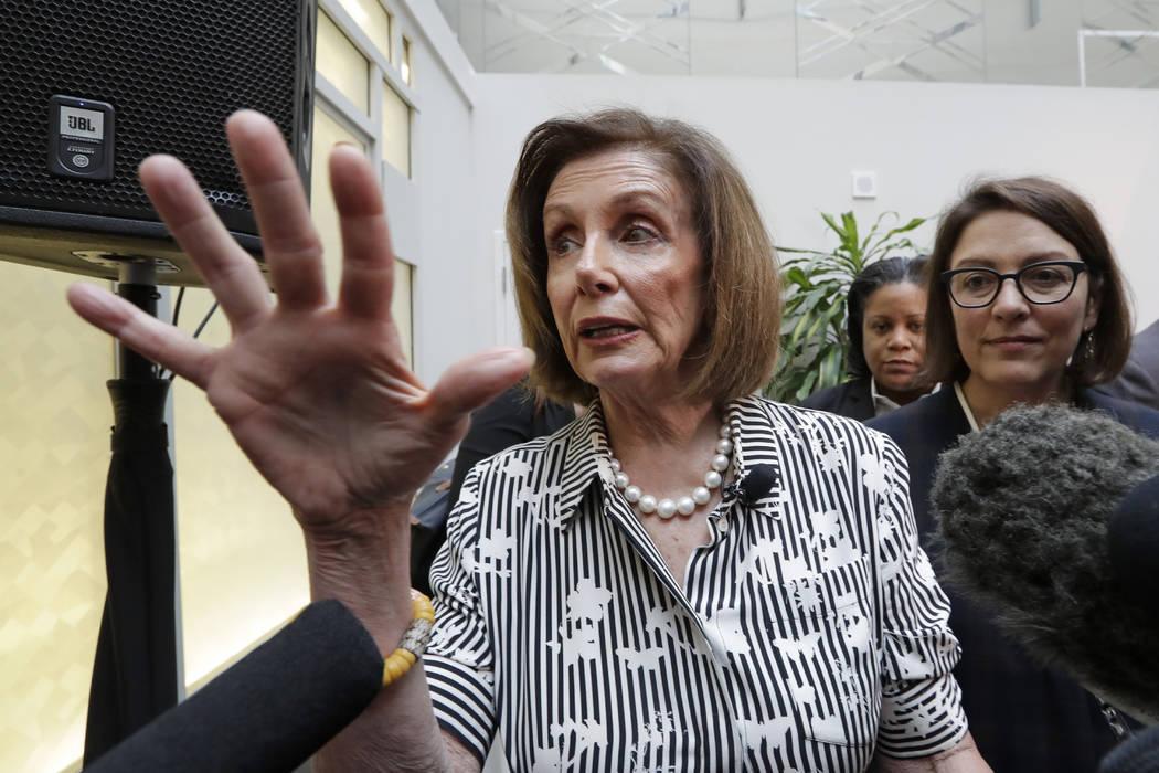 Speaker of the House Nancy Pelosi, D-Calif., left, speaks with media members with Rep. Suzan De ...