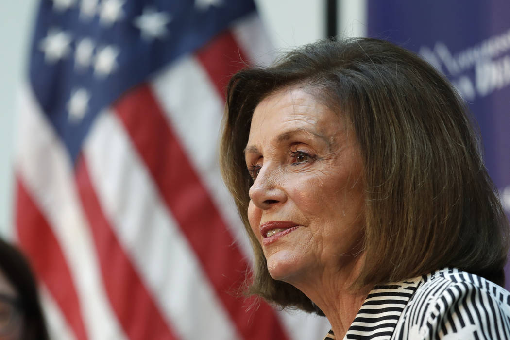Speaker of the House Nancy Pelosi, D-Calif., listens during a talk about lowering the cost of p ...