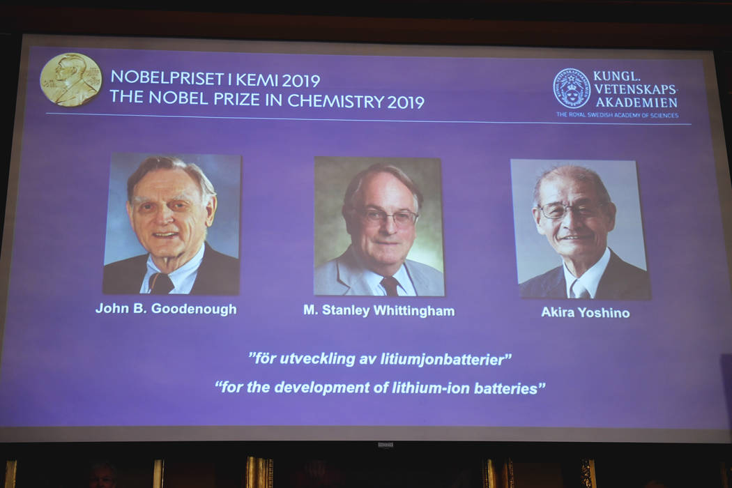 A screen displays the laureates of the 2019 Nobel Prize in Chemistry, from left, John B. Gooden ...