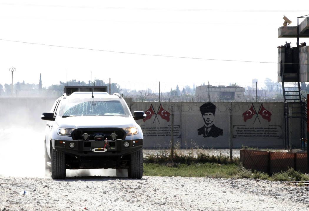 Backdropped by a graffiti of modern Turkey's founder Mustafa Kemal Ataturk on the Turkish side ...