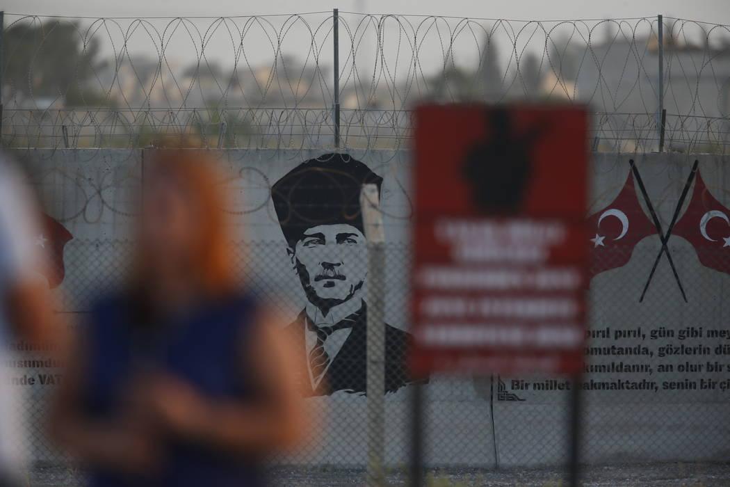 A graffiti of modern Turkey's founder Mustafa Kemal Ataturk is seen on the Turkish side of the ...