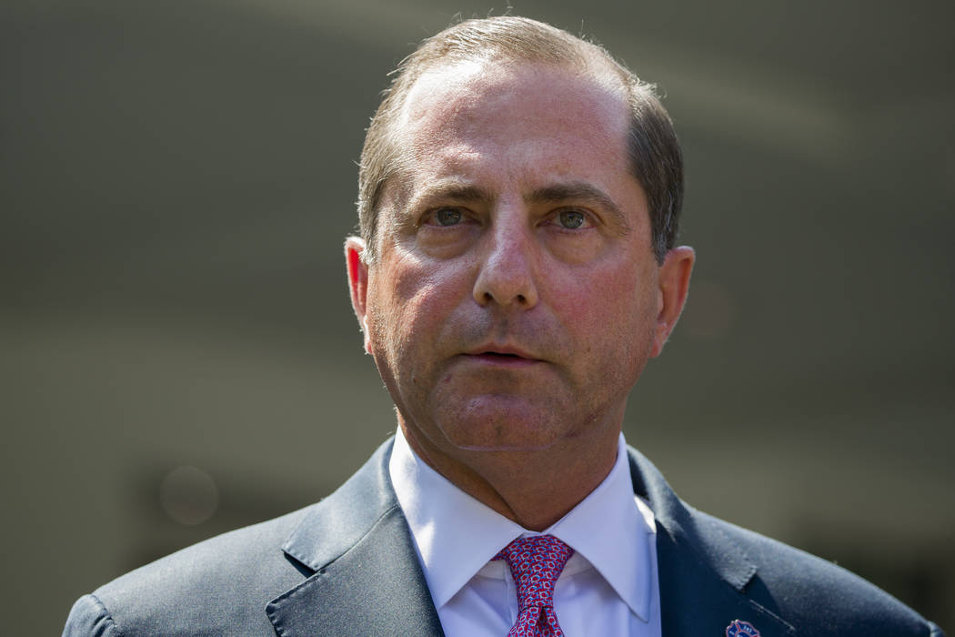 In a Sept. 11, 2019, file photo, Health and Human Services Secretary Alex Azar speaks with repo ...