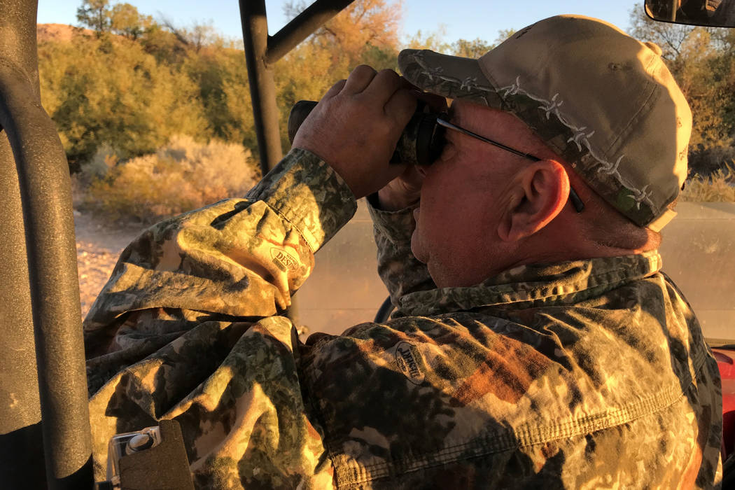Though he didn't have a tag himself, Jerry Swanson of Logandale provides glassing support for ...