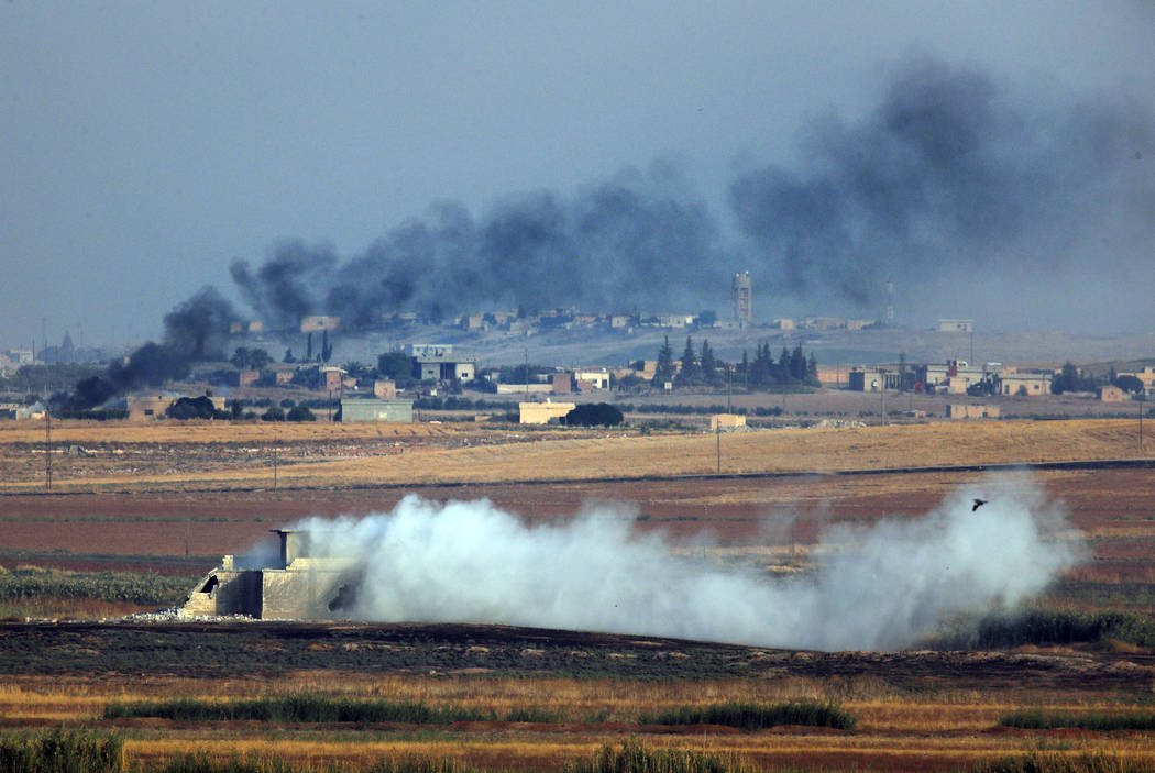 In this photo taken from the Turkish side of the border between Turkey and Syria, in Akcakale, ...