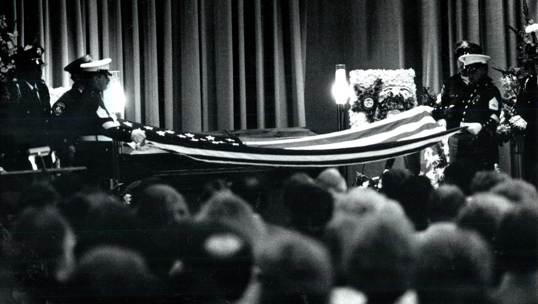Members of the Marine Corps fold a flag over the casket of slain FBI Agent John Bailey at Palm ...