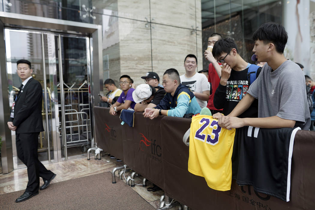 Chinese basketball fans gather outside of a hotel for a press conference that was later postpon ...