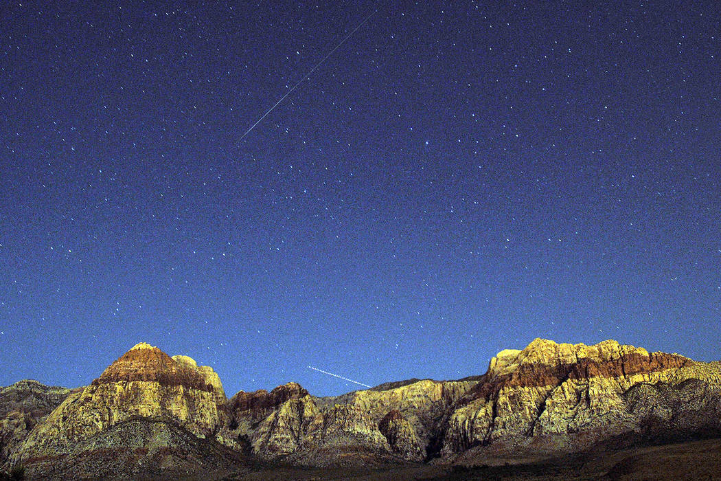 The walls of Red Rock Canyon outside of Las Vegas glow under the celestial lights late Tuesday, ...