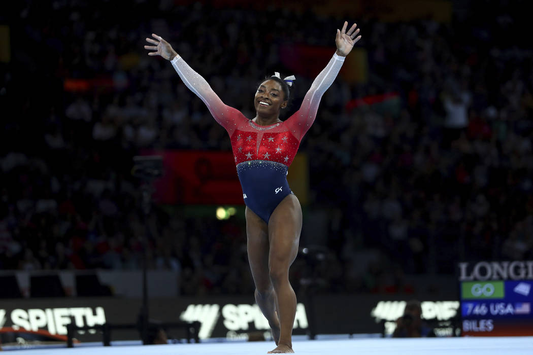 Simone Biles of the U.S. celebrates on the floor during women's team final at the Gymnastics Wo ...