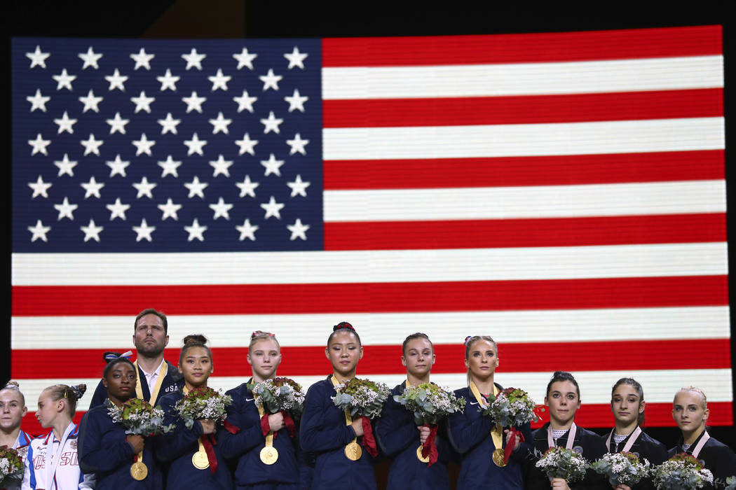 Team U.S.A. listens to the national anthem after winning the gold medal in the women's team fin ...