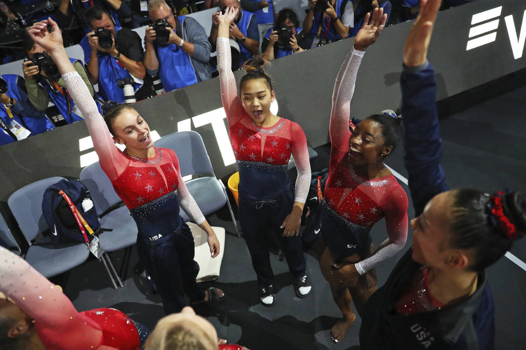 Team U.S.A. with Simone Biles, second right, celebrates winning the gold medal in the women's t ...