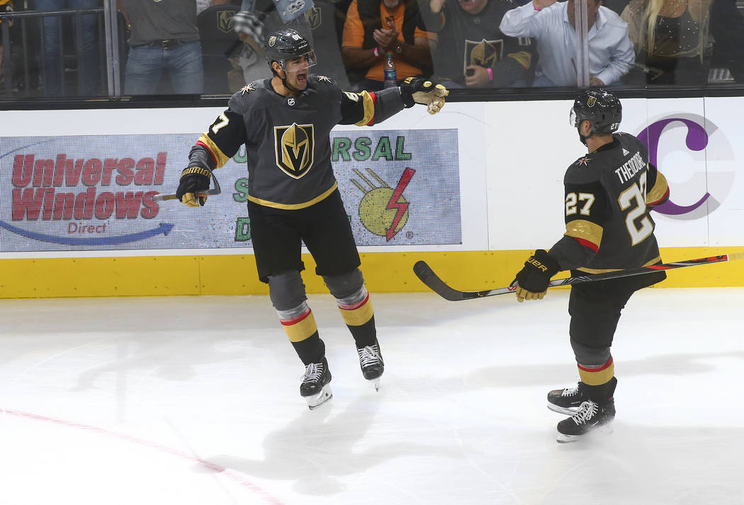 Golden Knights' Max Pacioretty (67) celebrates his goal with Shea Theodore (27) during the thir ...