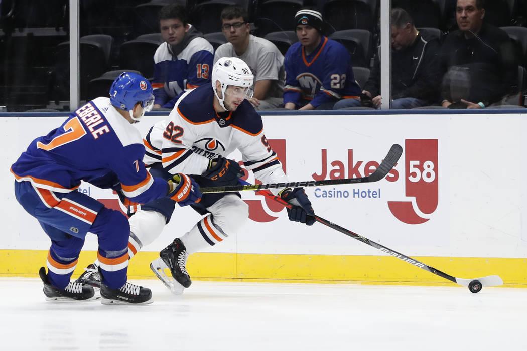 New York Islanders center Jordan Eberle (7) defends against Edmonton Oilers right wing Tomas Ju ...