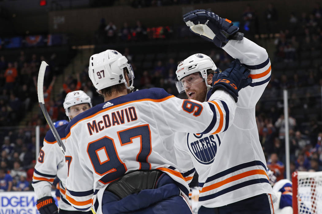 Edmonton Oilers left wing James Neal, right, celebrates with center Connor McDavid (97) after s ...