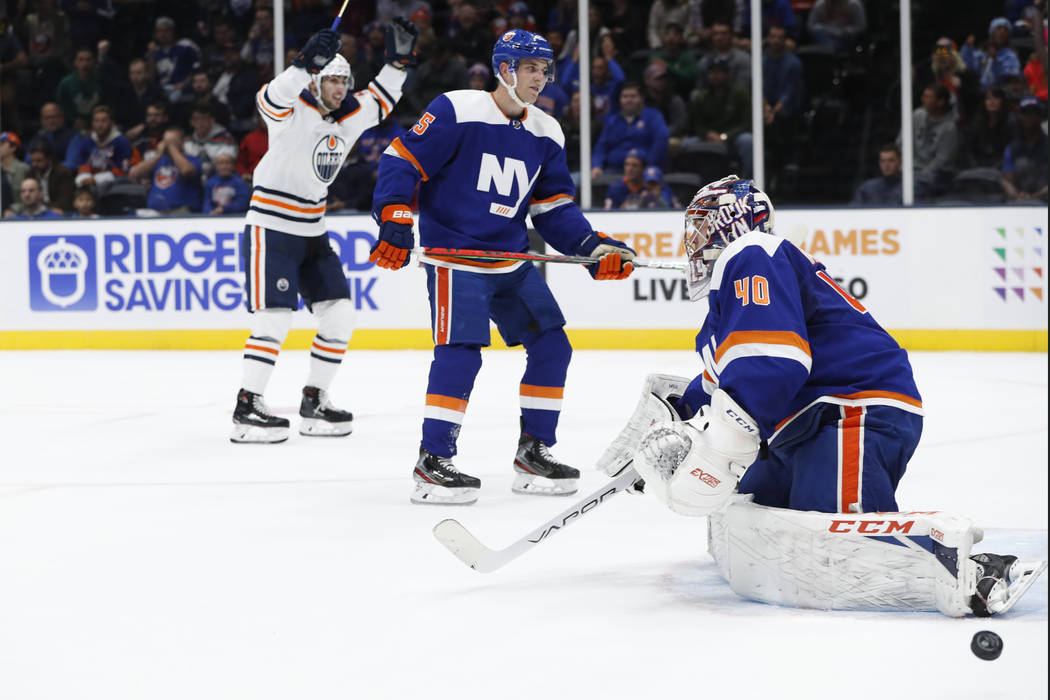 Edmonton Oilers left wing James Neal, left, celebrates after scoring a goal on New York Islande ...