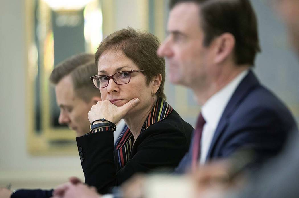 In a March 6, 2019, file photo, then U.S. Ambassador to Ukraine Marie Yovanovitch, center, sits ...