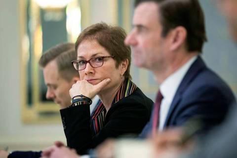 In a March 6, 2019, file photo, then U.S. Ambassador to Ukraine Marie Yovanovitch, center, sits ...