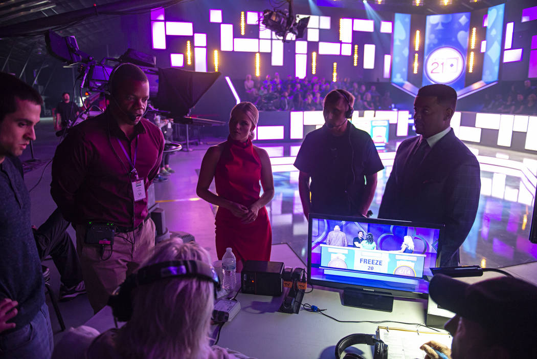 """Host Alfonso Ribeiro and dealer Witney Carson discusses the game show """"Catch 21"""" during a break ..."""