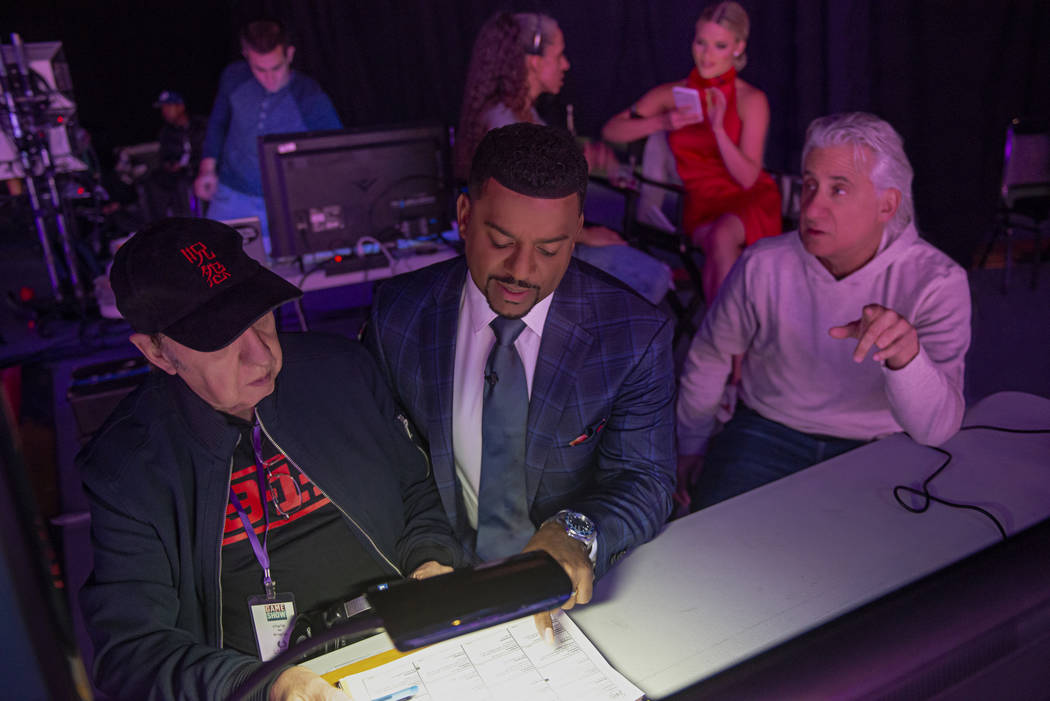 """Host Alfonso Ribeiro discusses the game show """"Catch 21"""" during a break in production at Caesars ..."""