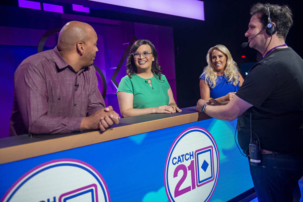 """Contestants wait for production to begin on an episode of the game show """"Catch 21,"""" filmed at C ..."""