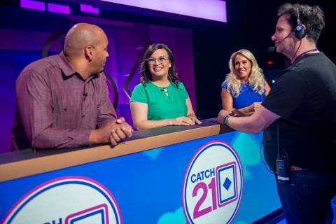 "Contestants wait for production to begin on an episode of the game show ""Catch 21,"" filmed at C ..."