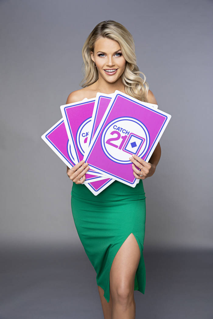 """Witney Carson serves as the dealer on the game show """"Catch 21,"""" filmed at Caesars Entertainment ..."""