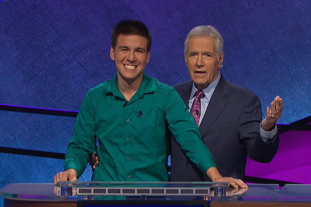 James Holzhauer and Jeopardy! host Alex Trebek (Jeopardy Productions, Inc.)