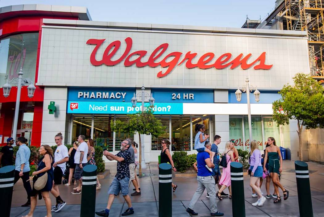 eople walk by the Walgreens on the Las Vegas Strip on Tuesday, Sept. 10, 2019, in Las Vegas. (M ...