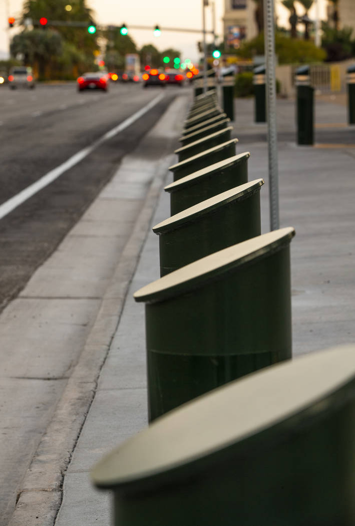 A shortened row of bollards are seen near an exit onto Las Vegas Boulevard South at the Excalib ...
