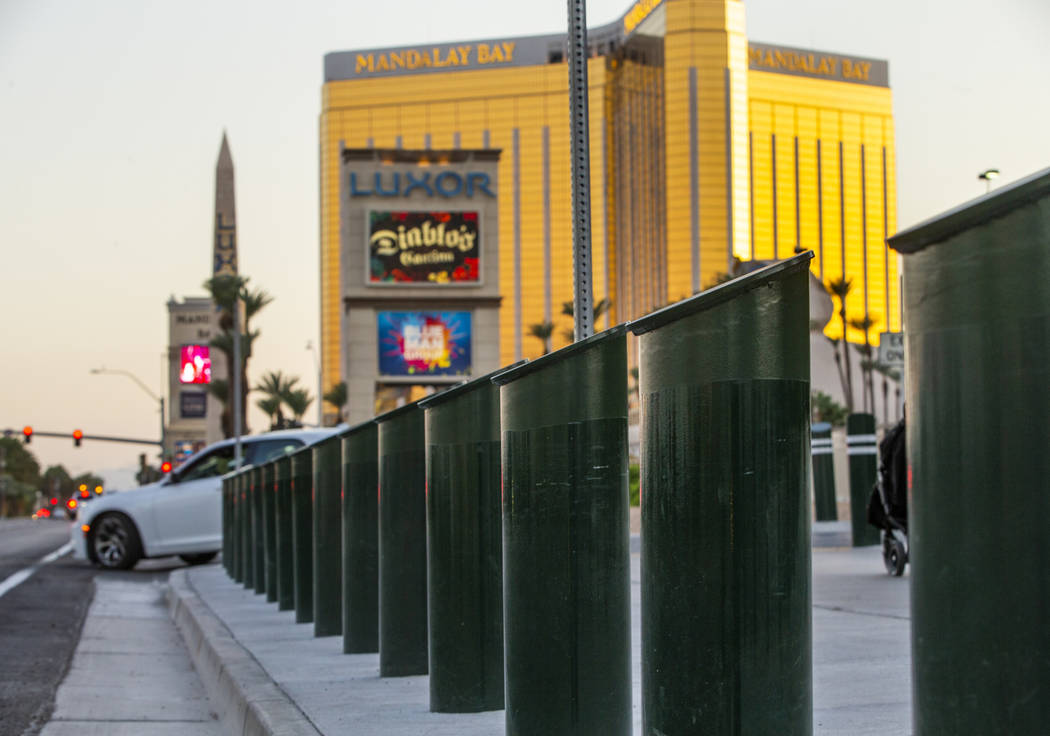 A shortened row of bollards are seen near an exit onto Las Vegas Boulevard South at t ...