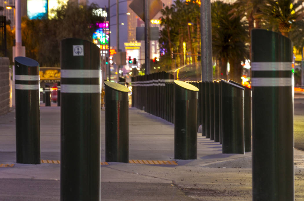 Various sizes of bollards are seen near an exit onto Las Vegas Boulevard South just u ...