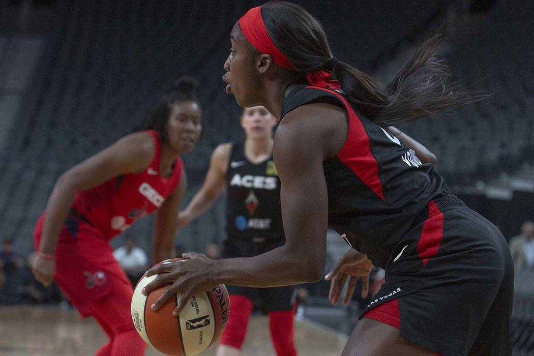 Las Vegas Aces guard Jackie Young (0) sets up a play against Washington Mystics players at T-Mo ...