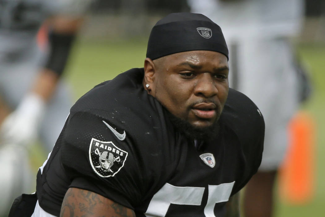 FILE - In this July 29, 2019, file photo, Oakland Raiders linebackers Vontaze Burfict gets up a ...