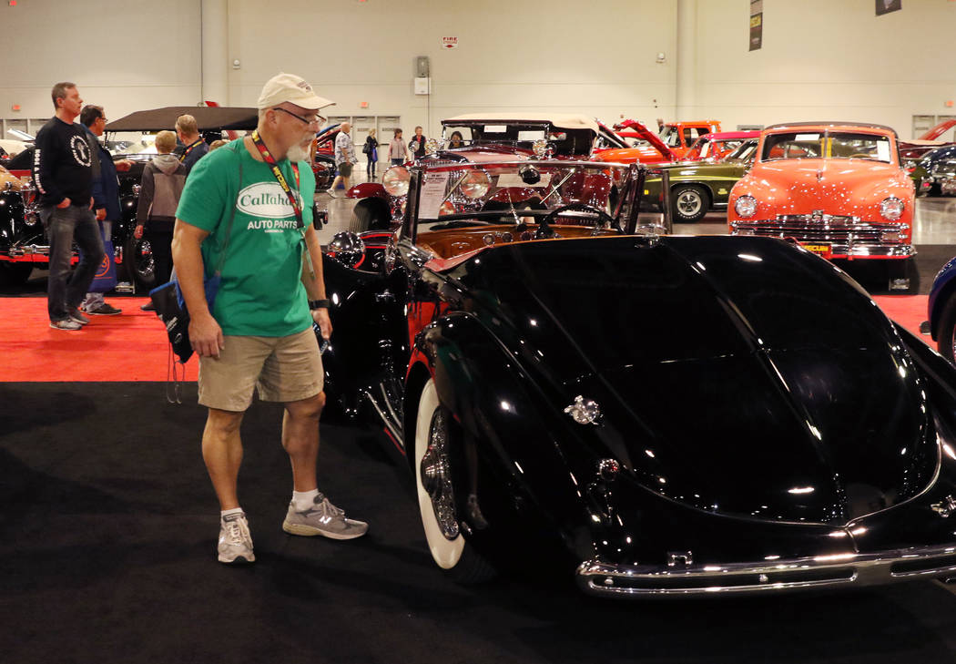 Auctiongoers check out classic cars at the Las Vegas Convention Center during the Mecum Car Auc ...