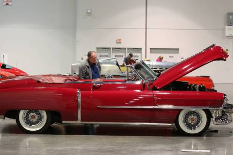 Joe Haduch checks out a 1953 Cadillac Series 62 Convertible during the Mecum Car Auction at the ...