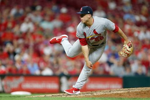 St. Louis Cardinals relief pitcher Ryan Helsley throws against the Cincinnati Reds during the e ...