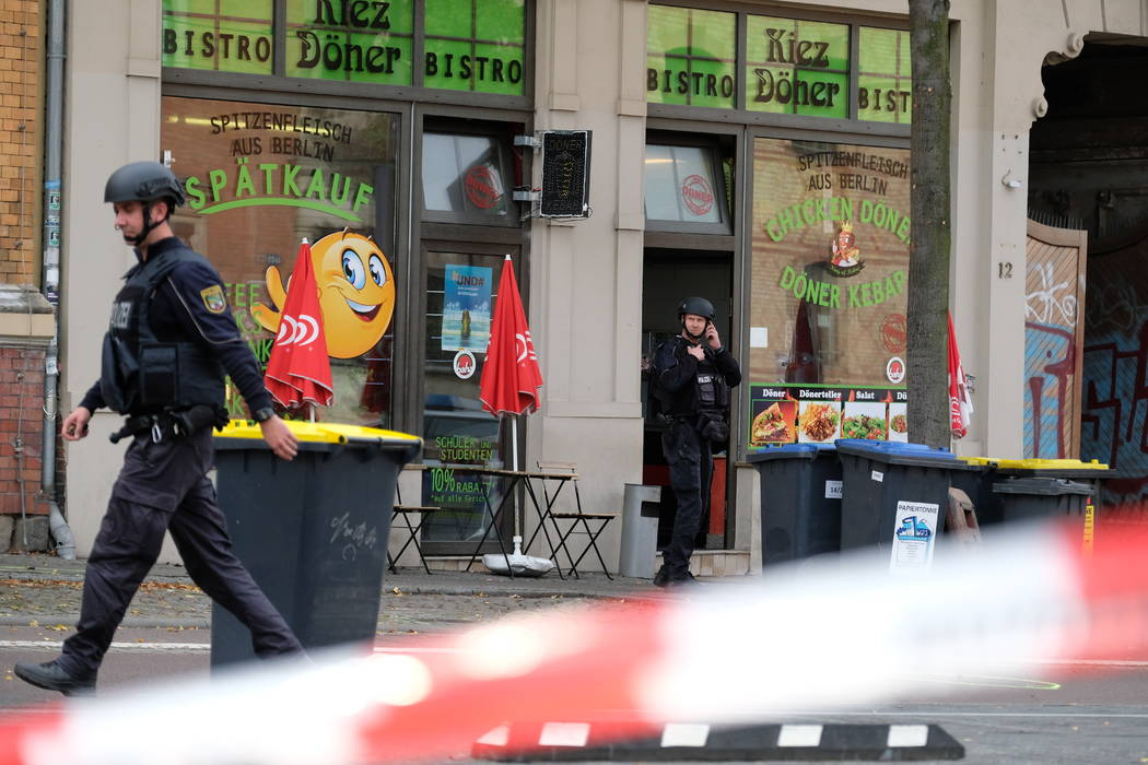 A police officer walks in front of a kebab grill in Halle, Germany, Wednesday, Oct. 9, 2019. A ...