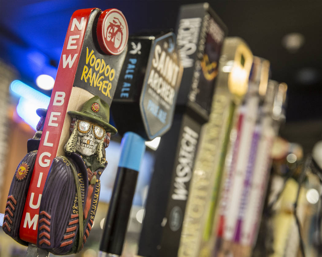 There are twelve micro beers on tap at Social Hour Beer and Wine Bar on Thursday, Oct. 10, 2019 ...