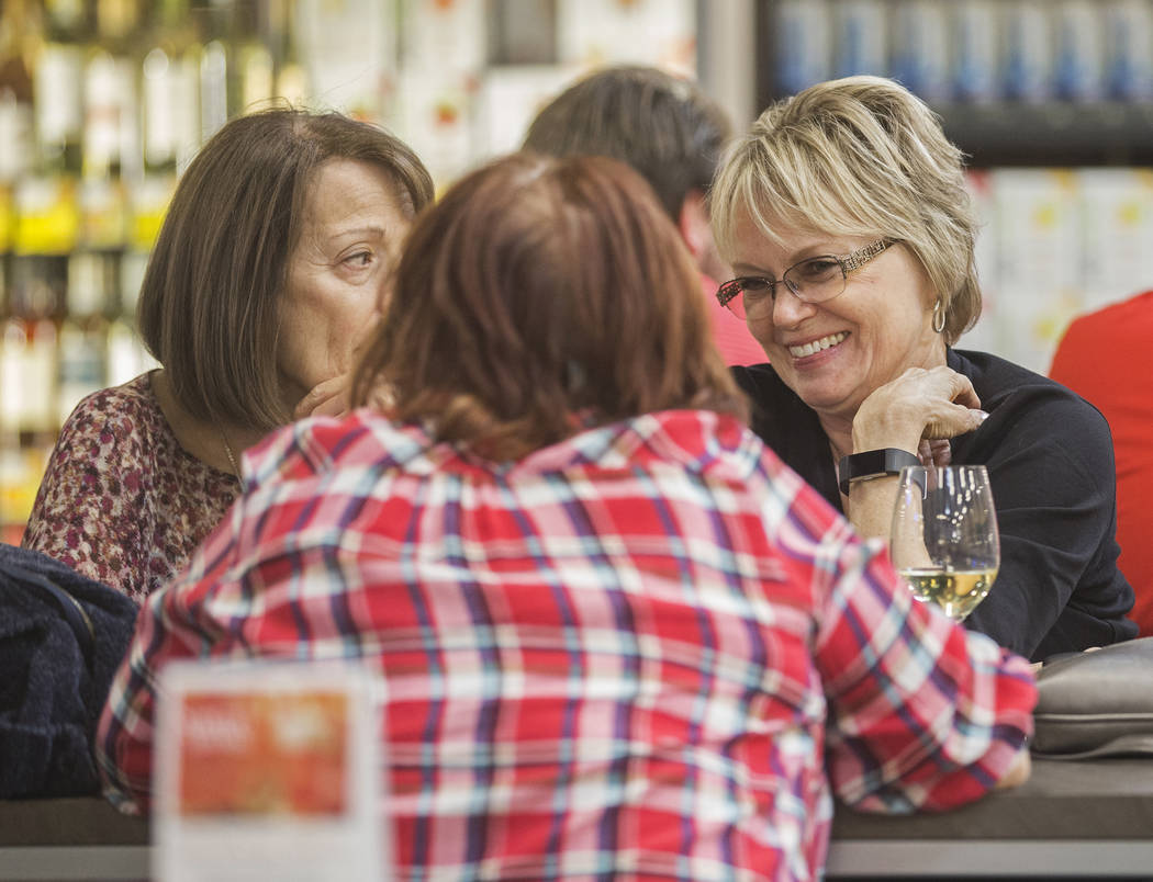 Jan Parsley, right, and Joanne Michel enjoy some wine at Social Hour Beer and Wine Bar on Thurs ...