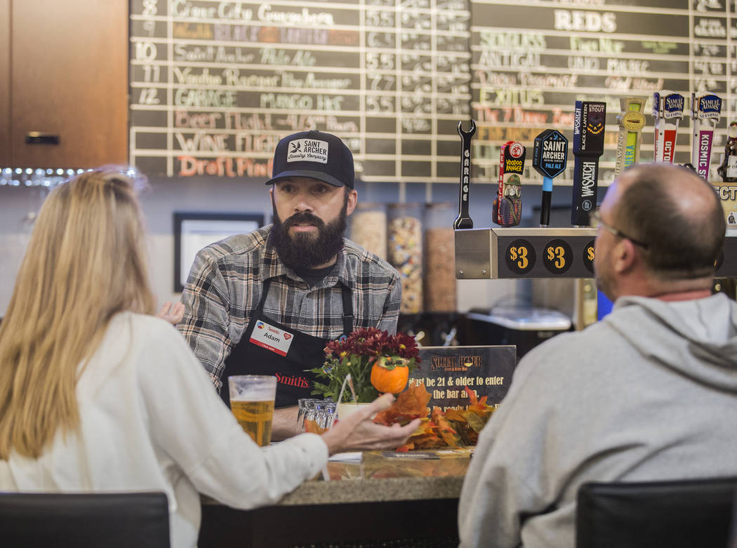 Bartender Adam Karli talks with patrons at Social Hour Beer and Wine Bar on Thursday, Oct. 10, ...