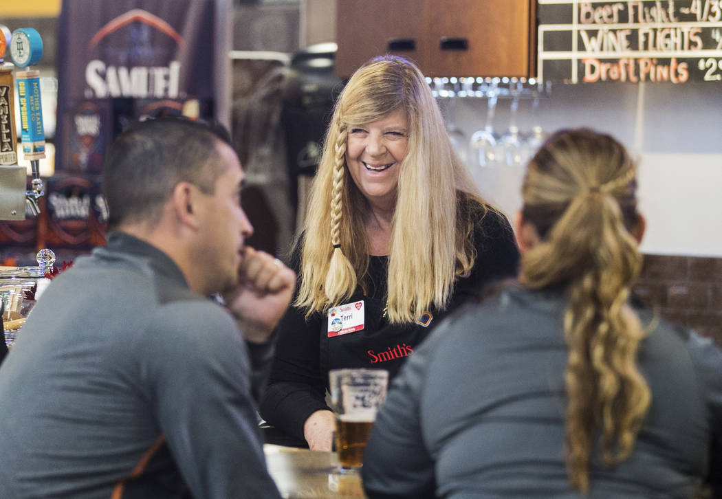 Bartender Terri Wirthlin, middle, talks with patrons at Social Hour Beer and Wine Bar on Thursd ...