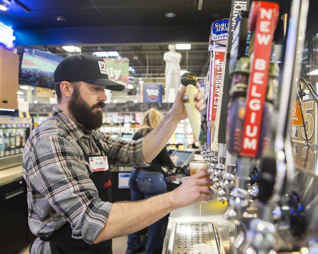 Bartender Adam Karli pours a beer at Social Hour Beer and Wine Bar on Thursday, Oct. 10, 2019, ...