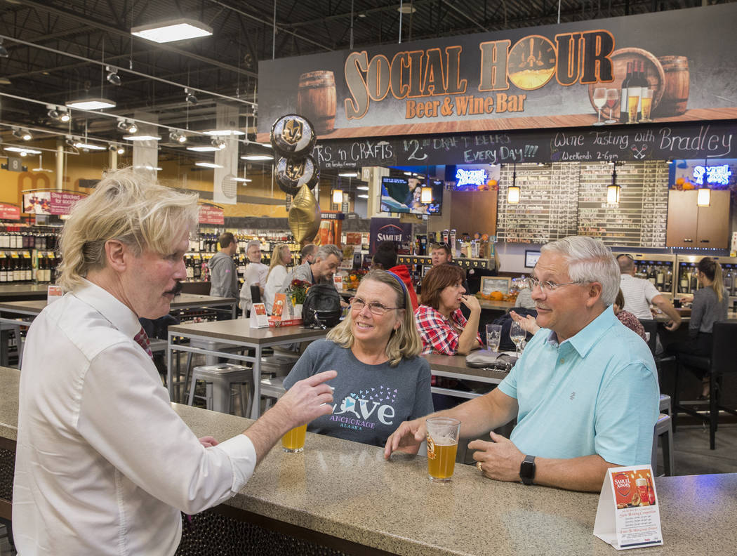 Wine steward Bradley Pugh, left, talks with Ron and Deb Crowl, from Anchorage, AK., at Social H ...